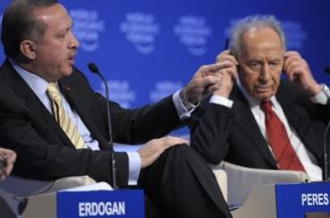 Israel's President Shimon Peres, right, looks on as Turkey's Prime Minister Recep Tayyip Erdogan makes a point while speaking during a session at the World Economic Forum in Davos, Switzerland, Thursday Jan. 29, 2009. (AP Photo/Michel Euler)