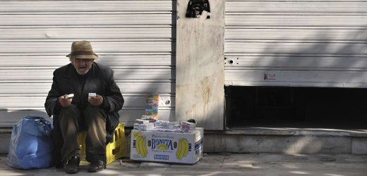"An old man sells tissues outside a store in central Athens on December 10, 2009. Greece's prime minister on Thursday called an all-party crisis meeting aiming to reassure panicked markets that Athens is ready to ""clean up"" its economy, as Europe's central bank urged bold measures. The financial crisis engulfing Greece is ""very serious,"" requires ""support"" from fellow EU member states and will be discussed by leaders at a summit dinner in Brussels later Thursday, the bloc's Swedish presidency said.AFP PHOTO / Aris Messinis"